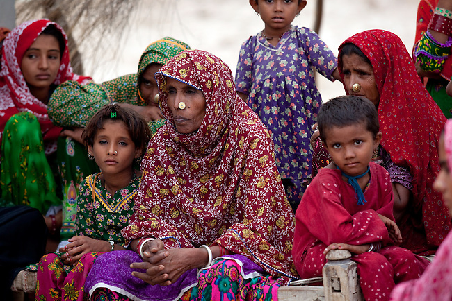 25 JULY 2011: Basti Mahraan Village, Punjab, Pakistan.  Hindu women sit near a Hindu temple that was renovated with the help of the Muslim villagers.  Mahar Abdul Latif, a former member of Muslim terrorist group Lashkar-i-Taiba (LeT) found his views towards Hindu's change after  Bachu Ram, a Hindu offered to donate his rare blood type to save the life of a Muslim woman. As a result relations  have thawed in the traditional violence between the Muslims and Hindu's of the village. Picture by Graham Crouch/Toronto Star.
