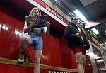 (Boston MA 01/07/18) Matthew Santens of Boston, left, and Nathan Giusti of Cambridge, look perfectly normal reading while waiting for the train, if not for the fact they weren't wearing any pants, at Harvard Station, during the annual no pants subway ride, Sunday, January 7, 2018, in Boston. This is an annual global event started in New York in 2002. The brief ride through several lines lasted about 90 minutes and was smaller in numbers compared to the previous years organizers attributing that to the bone chilling weather. Herald Photo by Jim Michaud