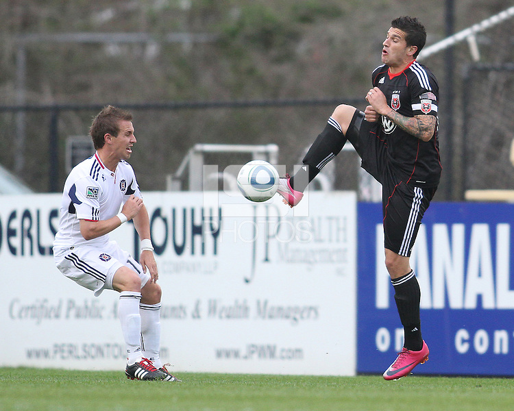 Santino Quaranta#25 of D.C. United punches a high ball past Daris Paul #17 of the Chicago Fire during a second round match of the Carolina Challenge on March 9 2011 at Blackbaud Stadium, in Charleston, South Carolina. D.C. United won 1-0.