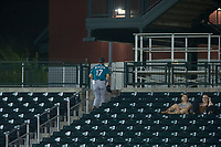 AZL Mariners manager Yoel Monzon (17) exits the stadium through the stands after having been ejected from the game against the AZL Cubs on August 4, 2017 at Sloan Park in Mesa, Arizona. AZL Cubs defeated the AZL Mariners 5-3. (Zachary Lucy/Four Seam Images)