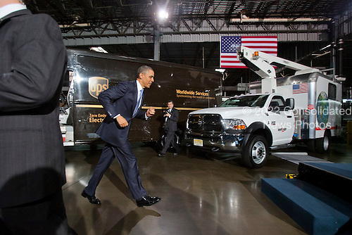 United States President Barack Obama prepares to deliver remarks to the employees of a UPS shipping facility in Landover, MD after viewing vehicles from AT&T, PepsiCo, UPS and Verizon's clean fleets, at the same location in Landover, Maryland, USA, on April 01 2011..Credit: Jim LoScalzo / Pool via CNP