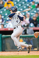 Derek Hamilton #4 of the Rice Owls follows through on his swing against the Baylor Bears at Minute Maid Park on March 6, 2011 in Houston, Texas.  Photo by Brian Westerholt / Four Seam Images