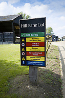 Farm safety sign at entrance to farm yard