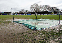 GENERAL VIEW: The Match is postponed due to a waterlogged pitch at 9.15 am by referee ANDREW MADLEY during the Sky Bet League 2 match between AFC Wimbledon and Portsmouth at the Cherry Red Records Stadium, Kingston, England on the 28th March 2016. Photo by Liam McAvoy.