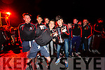 Pobalscoil Chorcha Dhuibhne players celebrating the winning of the Hogan Cup in Dingle on Saturday night.
