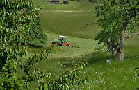 Tractor pulling grass cutter,Imst district, Tyrol/Tirol, Austria, Alps.