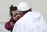 Papa Francesco celebra la messa per la Domenica delle Palme in Piazza San Pietro, Citta' del Vaticano, 24 marzo 2013..Pope Francis greets a child at the end of the Palm Sunday Mass in St. Peter's square at the Vatican, 24 March 2013..UPDATE IMAGES PRESS/Riccardo De Luca..STRICTLY ONLY FOR EDITORIAL USE