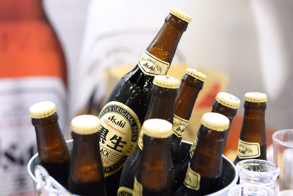 Still life photo of bottles of beer on ice at a food event