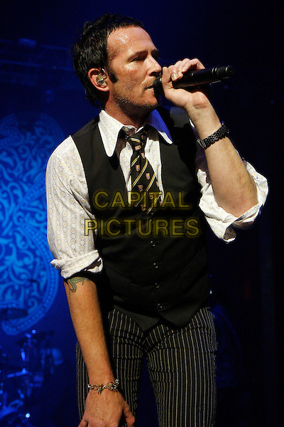 STONE TEMPLE PILOTS - SCOTT WEILAND .Performing live at the Brixton Academy, London, England..June 16th, 2010.stage concert live gig performance music half length black shirt pinstripe white shirt waistcoat singing stubble facial hair grey gray.CAP/MAR.© Martin Harris/Capital Pictures.