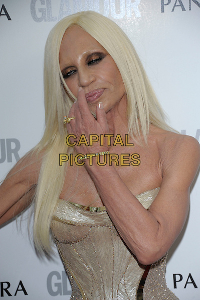 Donatella Versace.Women Of The Year 2012 - Glamour Awards, Berkeley Square, London, England..29th May 2012.half length gold corset strapless cleavage eyes closed hand arm funny .CAP/PL.©Phil Loftus/Capital Pictures.