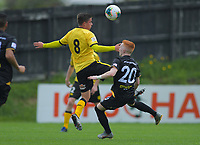 Wellington Phoenix's Henry Hamilton and Team Wellington's Oliver Bassett compete for the ball during the ISPS Handa Premiership football match between Team Wellington and Wellington Phoenix Reserves at David Farrington Park in Wellington, New Zealand on Sunday, 17 November 2019. Photo: Dave Lintott / lintottphoto.co.nz