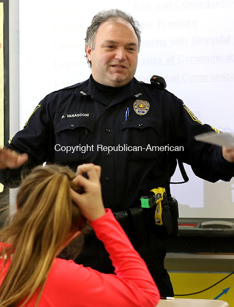 WINSTED CT. 11 January 2015-011116SV08-Sgt. Robert Varasconi explains about the DARE program to 6th graders at Pearson School in Winsted Monday. Winsted police are bringing back the DARE program to the elementary schools after eliminating it 4,5 years ago, likely due to budget cuts and manpower shortages. <br /> Steven Valenti Republican-American
