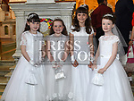 Caitlyn Kinsella, Jena Kearney, Ida Niedubek and Emily Buckley from St Brigids school who recieved first holy communion in Our Lady of Lourdes church. Photo:Colin Bell/pressphotos.ie