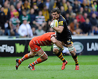 Guy Thompson of Wasps is tackled by Graham Kitchener of Leicester Tigers