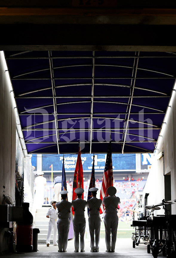 The Naval Academy Color Guard practices before the college football game between the Ohio State Buckeyes and the Navy Midshipmen at M&T Bank Stadium in Baltimore, Saturday morning, August 30, 2014. (The Columbus Dispatch / Eamon Queeney)