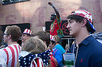 Kansas City, MO - Monday, June 16, 2014:  Ghanian soccer fan Ellison Ow cheers after his Ghana scored a goal in the second half during the USA vs. Ghana first round World Cup match at a public viewing in the Power and Light District of Kansas City, Missouri.