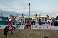 Jennifer Vass of Hungary celebrates her victory as her horse Cordoba is being lead away after winning the National Galop equestrian festival in Budapest, Hungary on September 16, 2012. ATTILA VOLGYI