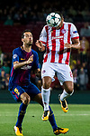 Vadis Odjidja Ofoe (r) of Olympiacos FC fights for the ball with Sergio Busquets Burgos of FC Barcelona during the UEFA Champions League 2017-18 match between FC Barcelona and Olympiacos FC at Camp Nou on 18 October 2017 in Barcelona, Spain. Photo by Vicens Gimenez / Power Sport Images