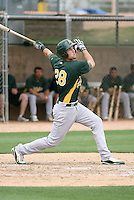 Jordan Tripp #28 of the Oakland Athletics plays in an extended spring training game against the Chicago Cubs at the Athletics minor league complex on May 18, 2011  in Phoenix, Arizona. .Photo by:  Bill Mitchell/Four Seam Images.
