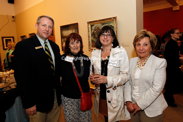 """Waterbury, CT- 02 May 2014-050214CM11- Social moments--- Left to right, Robert Burns, Director of the Mattatuck Museum, Georgia Sheron, an artist from Waterbury, Marilyn Maughan an artist from Southbury  and Donna Bannon with Bannon & Hebert Properties  of Middlebury, photographed during Waterbury Youth Service's Take a Seat…any seat """"CHAIR""""ity Auction and Reception at the Mattatuck Museum in Waterbury on Friday.   Christopher Massa Republican-American"""