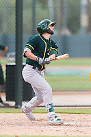 Oakland Athletics designated hitter Dustin Fowler (37) follows through on his swing during a rehab start in an exhibition game against Team Italy at Lew Wolff Training Complex on October 3, 2018 in Mesa, Arizona. (Zachary Lucy/Four Seam Images)