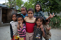A group of young children gather in the mountain town of Laclubar, Timor-Leste on Tuesday, Oct. 18th, 2011.  Photographer: Daniel J. Groshong/The Hummingfish Foundation