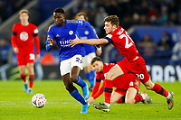 4th January 2020; King Power Stadium, Leicester, Midlands, England; English FA Cup Football, Leicester City versus Wigan Athletic; Joe Williams of Wigan Athletic attempts to pull back Wilfred Ndidi of Leicester City - Strictly Editorial Use Only. No use with unauthorized audio, video, data, fixture lists, club/league logos or 'live' services. Online in-match use limited to 120 images, no video emulation. No use in betting, games or single club/league/player publications