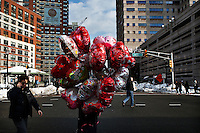 A woman carries globes during Valentine's Day in Jersey City, New Jersey, Feb 14, 2014. VIEWpress/Eduardo Munoz Alvarez
