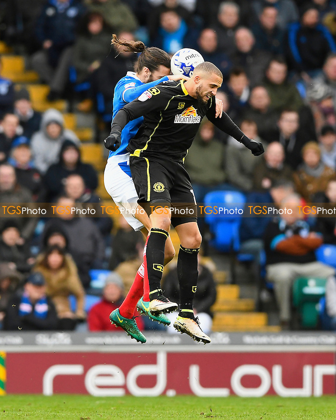 Christian Burgess of Portsmouth and Jordan Bowery of Crewe Alexandra vie for a header during Portsmouth vs Crewe Alexandra, Sky Bet EFL League 2 Football at Fratton Park on 4th March 2017
