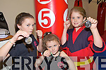 Winners - Friends Chelsea Dowling from Shanakil, pictured left, and Tara McGinty from Ballyduff, right, won gold and silver in the U11 section of The Irish Kickboxing Federation Junior National Championships in Galway on September 27th, Chelsea's sister Lauren, centre, also won silver in the U6 section representing Tralee School of Martial Arts.