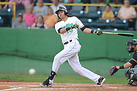 Shortstop Luis Caballero #10 of the Clinton LumberKings swings against the South Bend Silver Hawks at Ashford University Field on July 26, 2014 in Clinton, Iowa. The Sliver Hawks won 2-0.   (Dennis Hubbard/Four Seam Images)