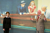 """In this photo released by the White House, first lady Laura Bush, left, stands with Rusty Powell, III, Director of the National Gallery of Art, right, prior to a tour of the Edward Hopper Exhibit at the National Gallery of Art in Washington, DC on September 21, 2007. They are standing in front of a poster featuring Edward Hopper's 1942 painting """"Nighthawks."""" <br /> Mandatory Credit: Joyce N. Boghosian / White House via CNP"""