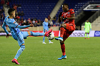 HARRISON, NJ - FEBRUARY 26: Jesus Medina #19 of NYCFC battles for the ball with Omar Browne #99 of AD San Carlos during a game between AD San Carlos and NYCFC at Red Bull on February 26, 2020 in Harrison, New Jersey.