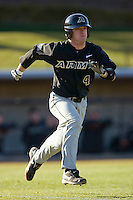 J.T. Watkins #4 of the Army Black Knights hustles down the first base line at the UNCG Baseball Stadium March 5, 2010, in Greensboro, NC.  Photo by Brian Westerholt / Four Seam Images