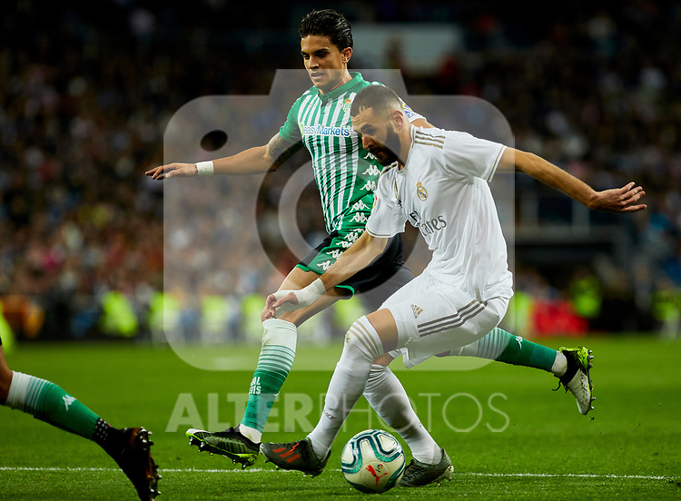 Karim Benzema of Real Madrid and Marc Bartra of Real Betis Balompie during La Liga match between Real Madrid and Real Betis Balompie at Santiago Bernabeu Stadium in Madrid, Spain. November 02, 2019. (ALTERPHOTOS/A. Perez Meca)