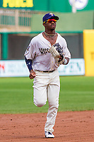 Wisconsin Timber Rattlers outfielder Troy Stokes (15) runs in from the outfield during a Midwest League game against the Lake County Captains on July 24, 2016 at Fox Cities Stadium in Appleton, Wisconsin. Lake County defeated Wisconsin 6-2. (Brad Krause/Four Seam Images)