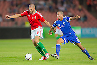 Hungary's Adam Szalai (L) and Israel's Avihay Yadin (R) fight for the ball during a friendly football match Hungary playing against Israel in Budapest, Hungary on August 15, 2012. ATTILA VOLGYI