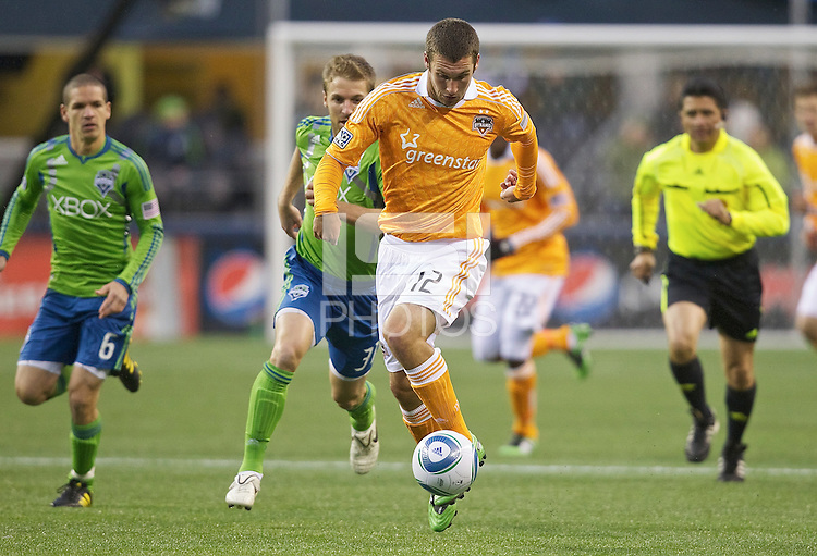 Houston Dynamo forward Will Bruin takes the ball up field during play against the Seattle Sounders FC at Qwest Field in Seattle Friday March 25, 2011. The match ended in a 1-1 draw.
