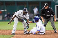 Seattle shortstop Yuniesky Betancourt attempts the tag on Royals shortstop Tony Pena as second base umpire Jeff Kellogg makes the safe call at Kauffman Stadium in Kansas City, Missouri on May 26, 2007.  The Mariners won, 9-1.