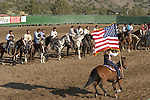 Riding with the Colors (U.S. flag) at the start of the Minden Ranch Rodeo at the Douglas County fairgrounds in Gardnerville, Nevada.