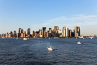 A view of lower Manhattan Skyline and boats in the New York Harbor.