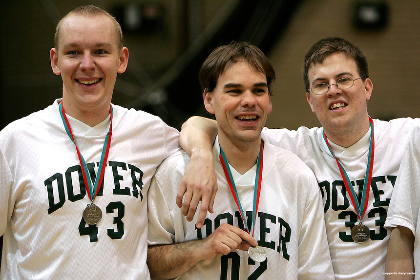 Dover basketball team members, left to right, Bartek Kaplinski of Dover, N.H., Gary Bado, of Rochester, N.H., and John Jenkins of Wakefield, N.H.,  with their metals during the Special Olympics held at the Portsmouth High School in Portsmouth, N.H., Sunday, April 13, 2008 (Portsmouth Herald Photo/Cheryl Senter)