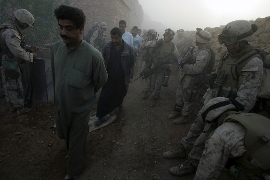 Marines from Golf Co. 2nd Battalion 1st Marines lead a group of men found in a house away for questioning to ascertain their whereabouts during the on-going push on the fifth day of Operation Steel Curtain, an operation to clear Husaybah (a city on the Iraq-Syrian border) of insurgents on Wed. 9, 2005. The men where subsequently released.