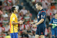 FC Barcelona's Pedro Rodriguez (l) have words with the referee Gonzalez Gonzalez during Supercup of Spain 1st match.August 14,2015. (ALTERPHOTOS/Acero)