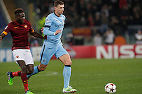 AS Roma's Mapou Yanga-Mbiwa   and Manchester City's Edin Dzeko during the Champions League Group E soccer match between As Roma and Manchester City  at the Olympic Stadium in Rome December 10 , 2014.