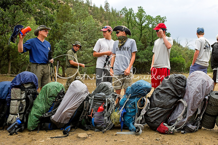 Photo story of Philmont Scout Ranch in Cimarron, New Mexico, taken during a Boy Scout Troop backpack trip in the summer of 2013. Photo is part of a comprehensive picture package which shows in-depth photography of a BSA Ventures crew on a trek. In this photo a BSA Venture Crew awaits instructions after being dropped off in the backcountry for the start of the trek at the Philmont Scout Ranch. <br /> <br /> Photo by travel photograph: PatrickschneiderPhoto.com