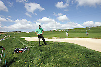 Charl Schwartzel contemplates his 2nd shot from the rough on the 18th hole in the 3rd Round of the Open de Espana in Madrid...Photo NEWSFILE/Eoin Clarke.(Photo credit should read Eoin Clarke/NEWSFILE)....This Picture has been sent you under the condtions enclosed by:.Newsfile Ltd..The Studio,.Millmount Abbey,.Drogheda,.Co Meath..Ireland..Tel: +353(0)41-9871240.Fax: +353(0)41-9871260.GSM: +353(0)86-2500958.email: pictures@newsfile.ie.www.newsfile.ie.FTP: 193.120.102.198..