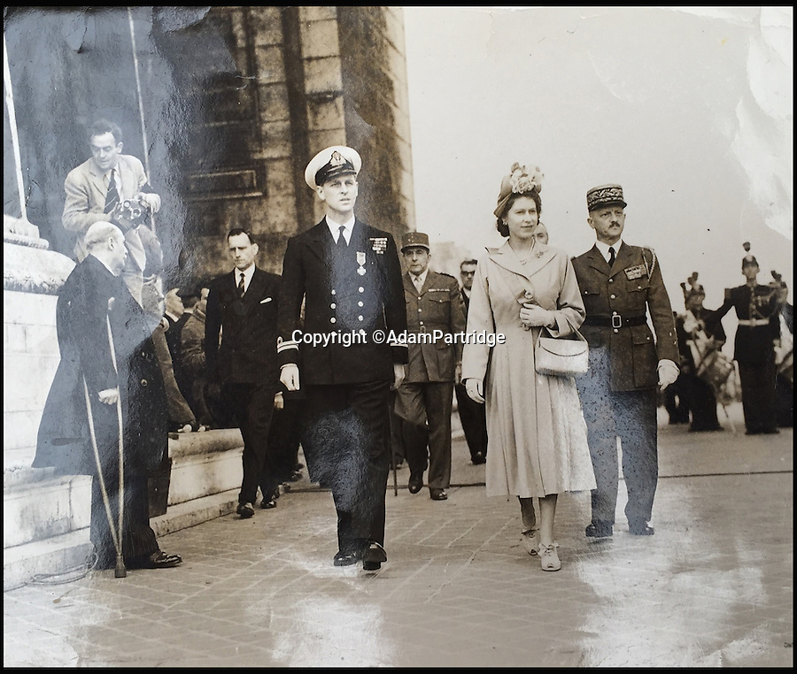 BNPS.co.uk (01202 558833)<br /> Pic: AdamPartridge/BNPS<br /> <br /> Alexander Usher pictured to the left.<br /> <br /> A fascinating photo archive that documents the dedication of one of the Queen's bodyguards has come to light 70 years later.<br /> <br /> Police Inspector Alexander Usher was appointed 'No.1 Shadow' to Princess Elizabeth in 1944, when she was aged 18 and 'heir presumptive' to the throne behind her father King George VI.<br /> <br /> Mr Usher served alongside her until 1951, by which time she had married Prince Philip. He even went on their honeymoon.<br /> <br /> The album of photo which he features in is now being sold by Adam Partridge auctioneers.