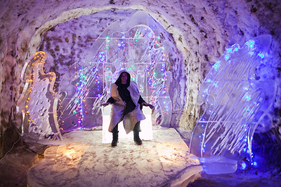 Yakutsk, Yakutia, Russia, 18/08/2011..Journalist Nick Holdsworth inside the Permafrost Kingdom, an underground tourist attraction inspired by the extreme cold of Yakutia. The 150 metre deep complex of tunnels in the Russian permafrost are decorated with ice sculptures, a wolf-fur covered throne, an office complete with the coolest computer and telephone, a children's slide and other ingenious creations - all hewn from blocks of ice.