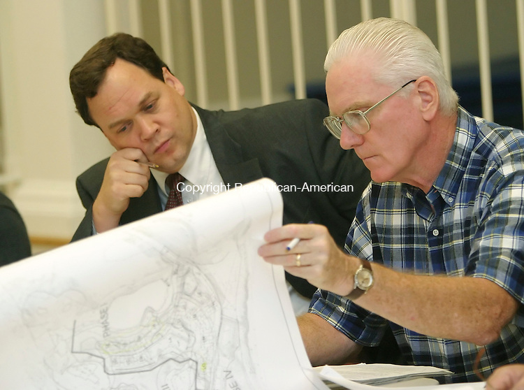 MIDDLEBURY,  CT 27 September 2005 -092705BZ05- Middlebury Conservation Commission members Steve Savarese, left, and commission  chairman Tom Gormley look over plans of the Straw Pond Development during their meeting Tuesday.<br /> Jamison C. Bazinet / Republican-American